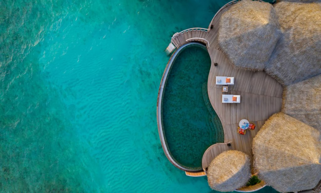 The Nautilus Maldives Luxury Resort - Thiladhoo Island, Maldives - Over Water Infinity Pool Aerial