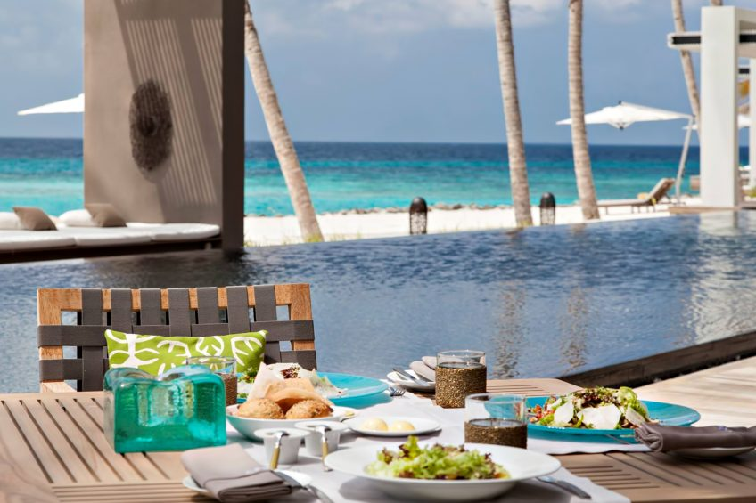 Cheval Blanc Randheli Luxury Resort - Noonu Atoll, Maldives - Infinity Pool Deck Dining Table