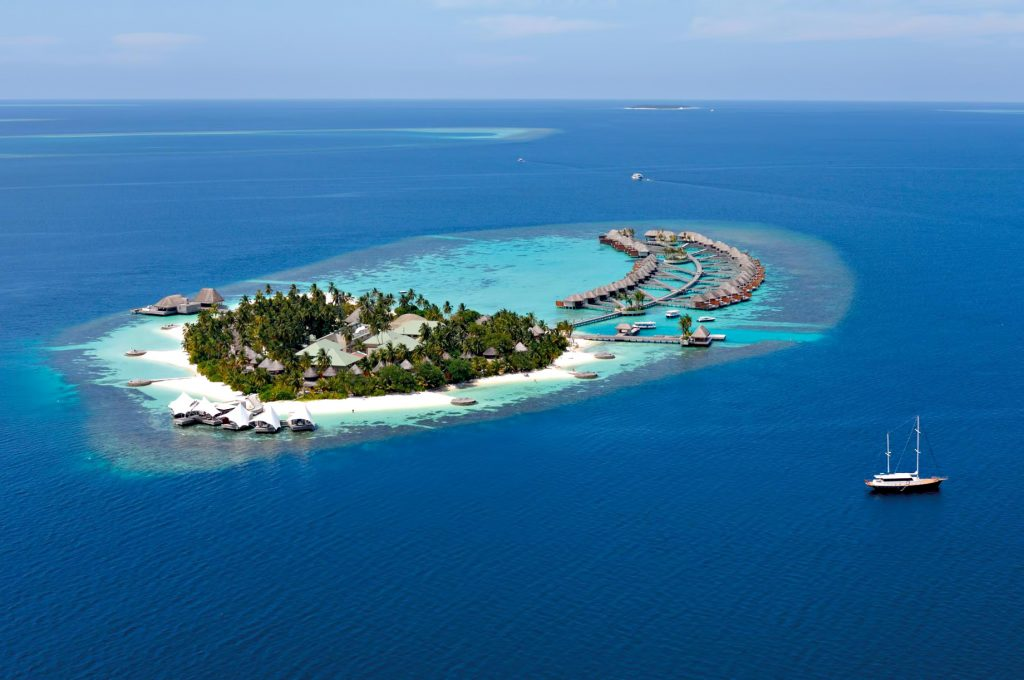 W Maldives Luxury Resort - Fesdu Island, Maldives - Resort Aerial Sailboat Departure