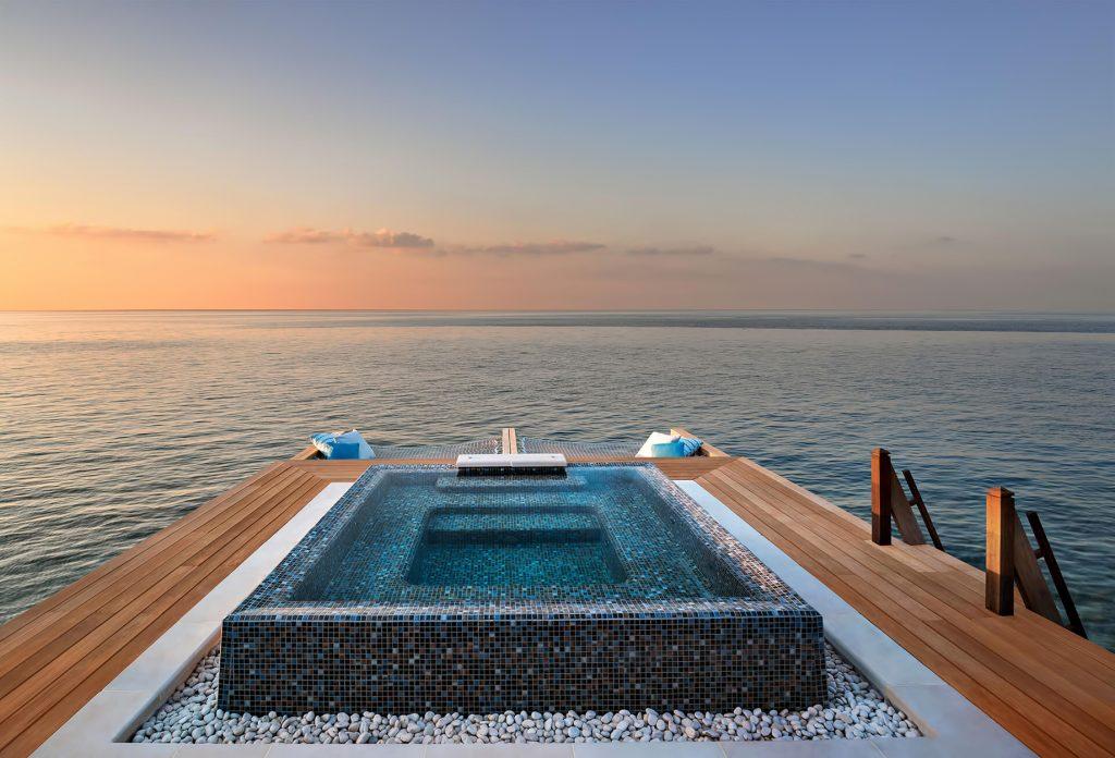 Waldorf Astoria Maldives Ithaafushi Luxury Resort - Ithaafushi Island, Maldives - Overwater Jacuzzi at Dusk