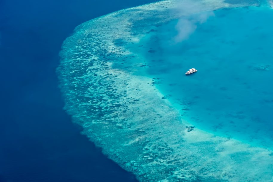 Cheval Blanc Randheli Luxury Resort - Noonu Atoll, Maldives - Boat on Indian Ocean Aerial