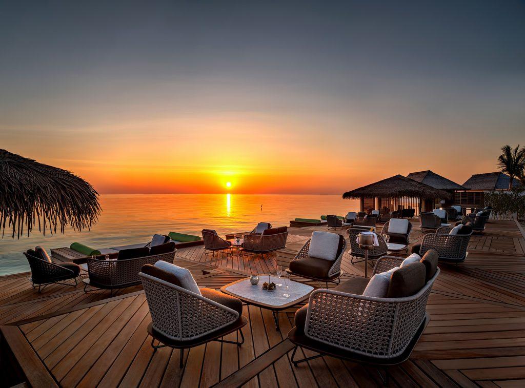 Waldorf Astoria Maldives Ithaafushi Luxury Resort - Ithaafushi Island, Maldives - Amber Restaurant Overwater Deck Sunset
