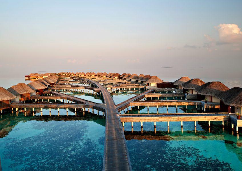 W Maldives Luxury Resort - Fesdu Island, Maldives - Resort Overwater Bungalows Dusk View
