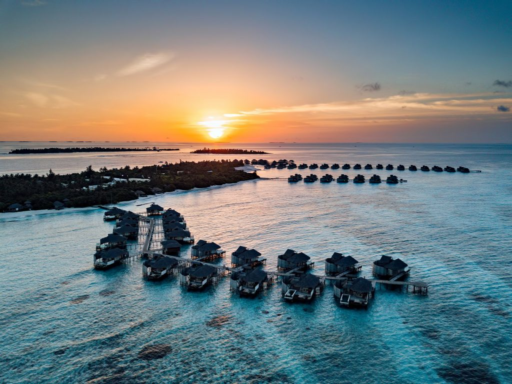 Six Senses Laamu Luxury Resort - Laamu Atoll, Maldives - Resort Aerial View Sunset