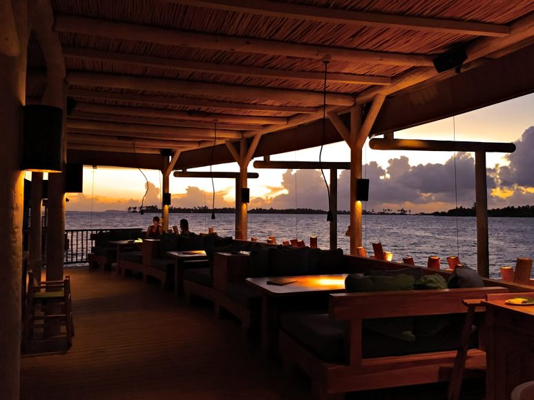 Six Senses Laamu Luxury Resort - Laamu Atoll, Maldives - Overwater Restaurant Sunset
