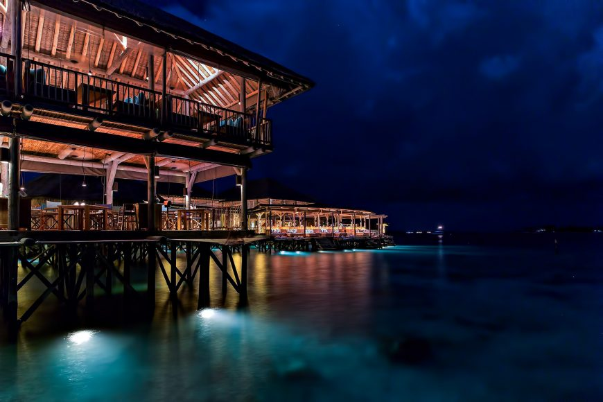 Six Senses Laamu Luxury Resort - Laamu Atoll, Maldives - Overwater Restaurant Night View