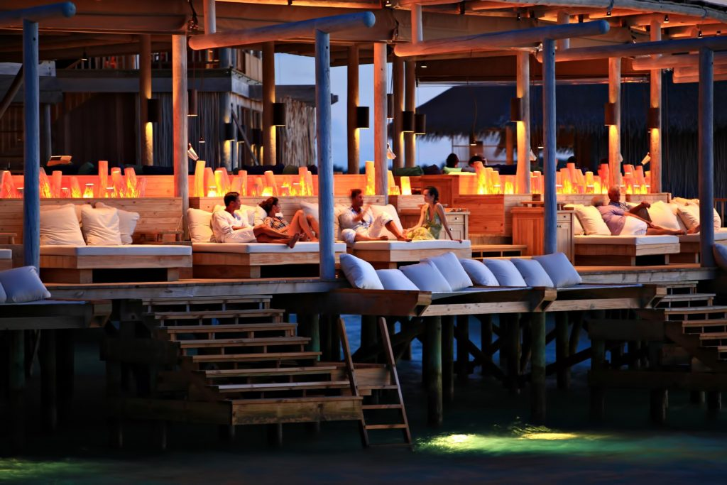 Six Senses Laamu Luxury Resort - Laamu Atoll, Maldives - Overwater Chill Bar Evening Vibe