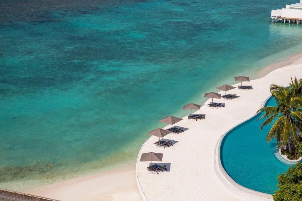 Amilla Fushi Luxury Resort and Residences - Baa Atoll, Maldives - Beachfront Pool Umbrellas Aerial