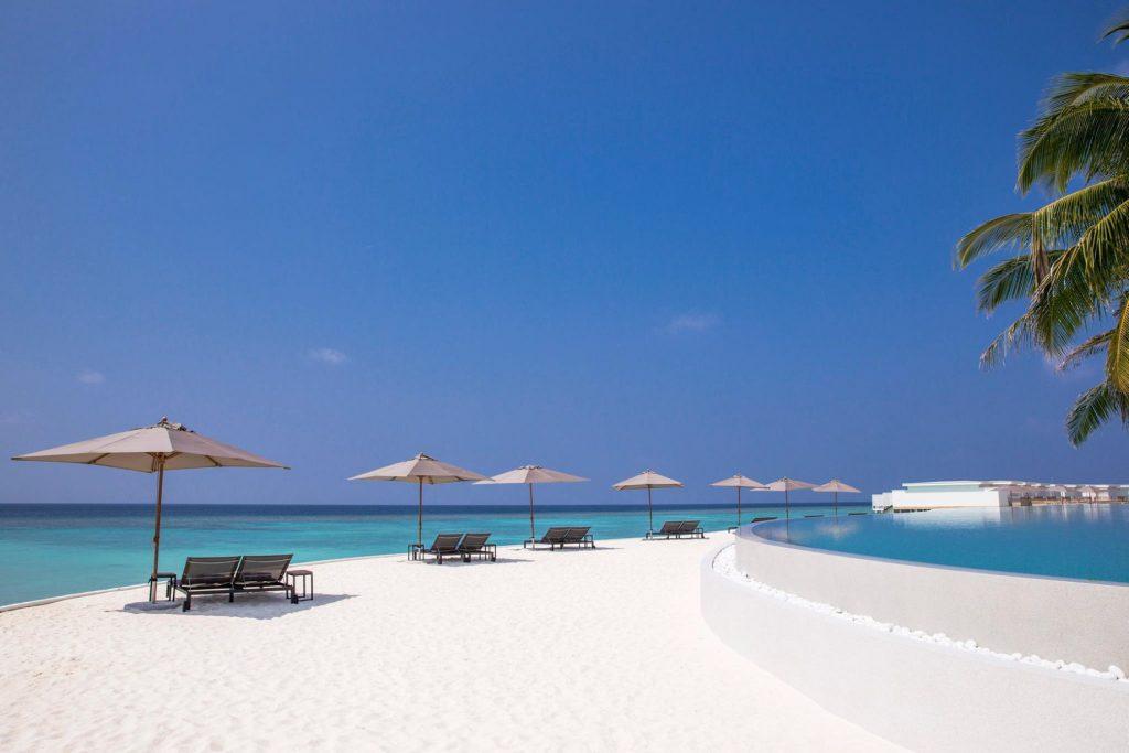 Amilla Fushi Luxury Resort and Residences - Baa Atoll, Maldives - Oceanfront Beach Chairs and Umbrellas