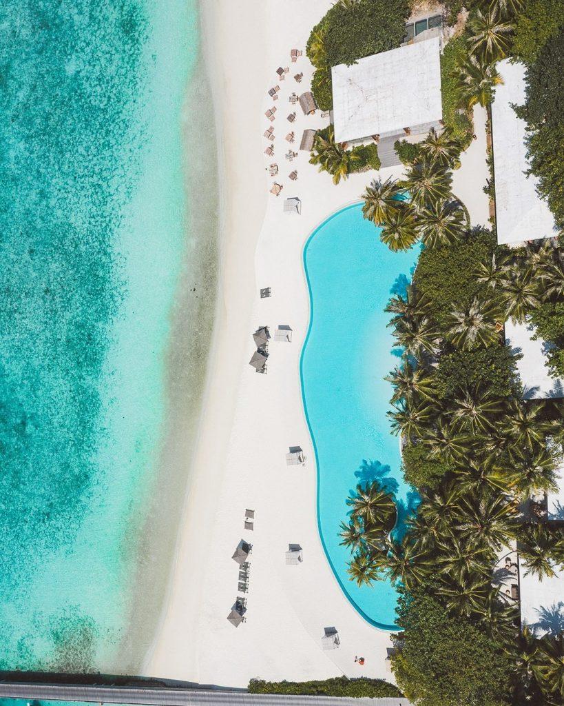 Amilla Fushi Luxury Resort and Residences - Baa Atoll, Maldives - Resort Oceanfront Infinity Edge Pool Overhead Aerial