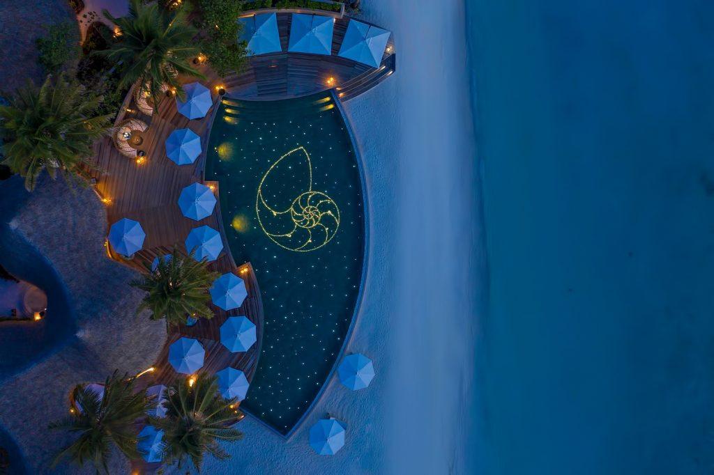 The Nautilus Maldives Luxury Resort - Thiladhoo Island, Maldives - Resort Pool Night Overhead View