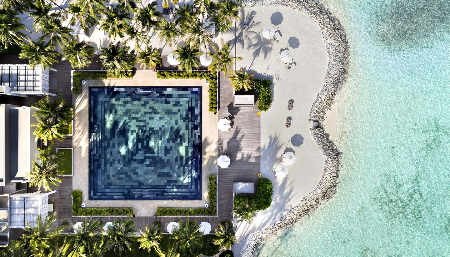 Cheval Blanc Randheli Luxury Resort - Noonu Atoll, Maldives - White Bar Beach Club Pool Overhead Aerial