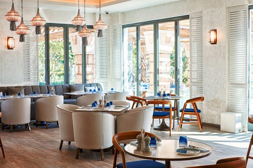 Atlantis The Palm Luxury Resort - Crescent Rd, Dubai, UAE - White Beach and Restaurant Interior