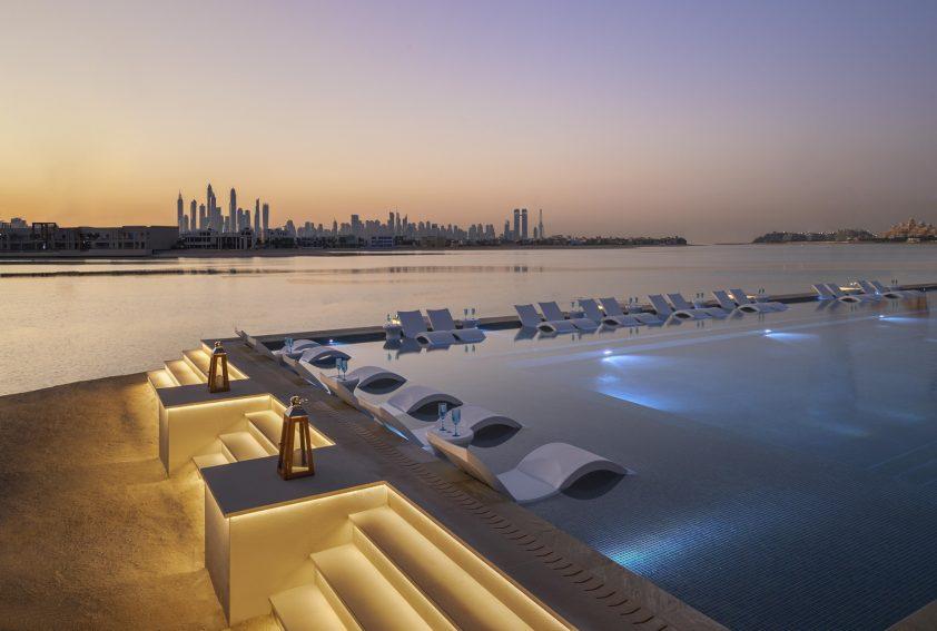 Atlantis The Palm Luxury Resort - Crescent Rd, Dubai, UAE - White Beach Club Pool Sunset