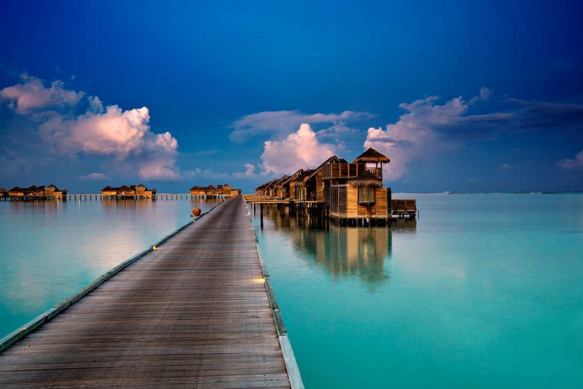 Gili Lankanfushi Luxury Resort - North Male Atoll, Maldives - Resort Jetty Boardwalk Dusk