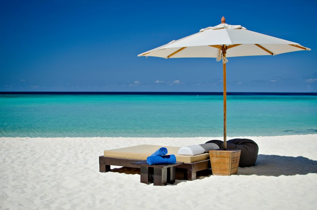 One&Only Reethi Rah Luxury Resort - North Male Atoll, Maldives - White Sand Beach Lounge Chair Sun Umbrella