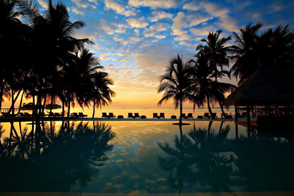 Gili Lankanfushi Luxury Resort - North Male Atoll, Maldives - Resort Beachfront Pool Sunset