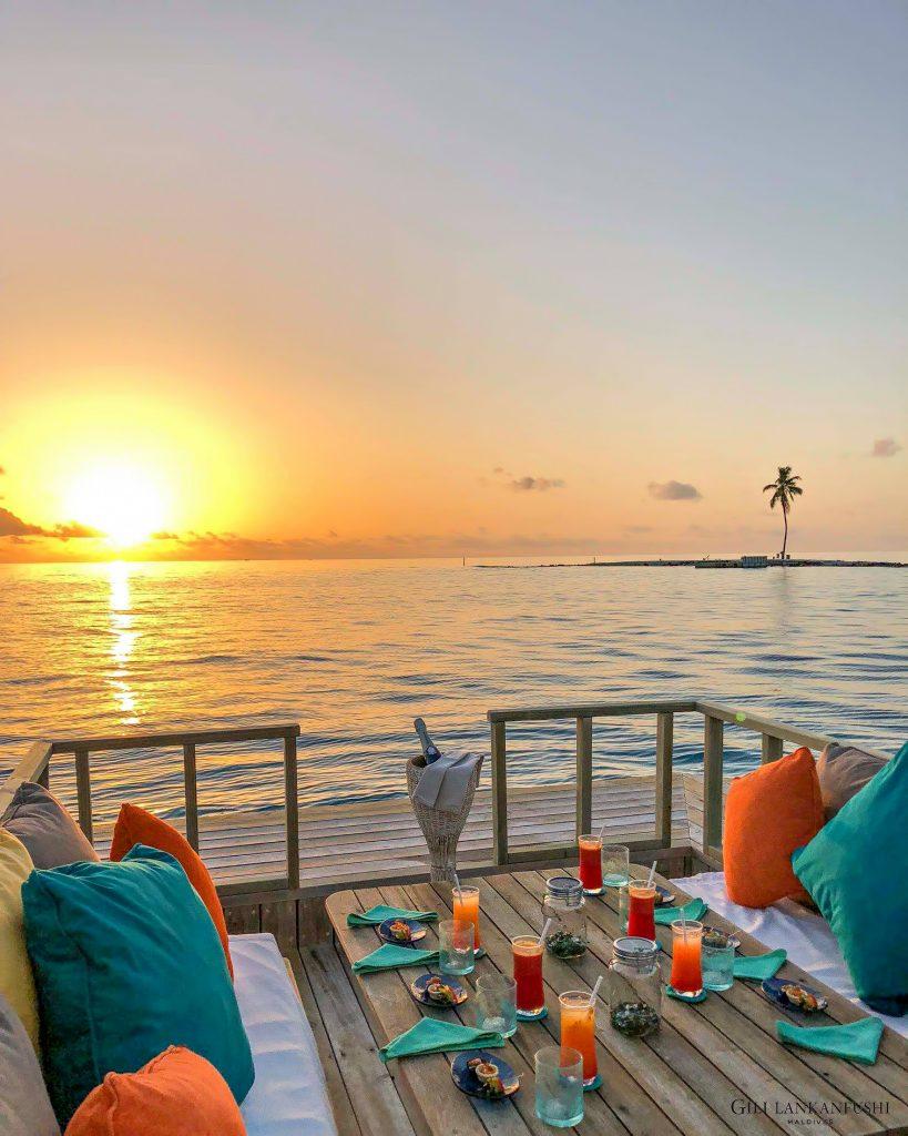 Gili Lankanfushi Luxury Resort - North Male Atoll, Maldives - Overwater Villa Outdoor Dining Lounge Sunset