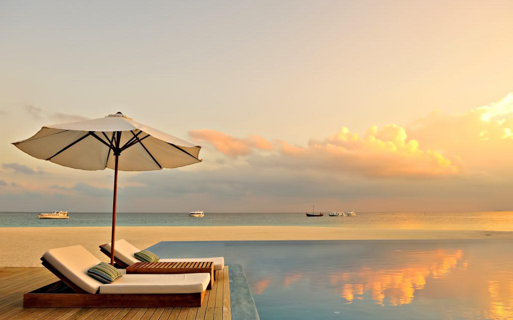 Velassaru Maldives Luxury Resort - South Male Atoll, Maldives - Infinity Pool Sunset