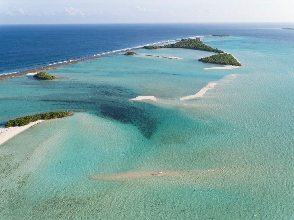 Soneva Jani Luxury Resort - Noonu Atoll, Medhufaru, Maldives - Table Dining in Tropical Ocean Water Aerial