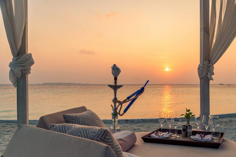 Amilla Fushi Luxury Resort and Residences - Baa Atoll, Maldives - Beach Lounge Dining Sunset