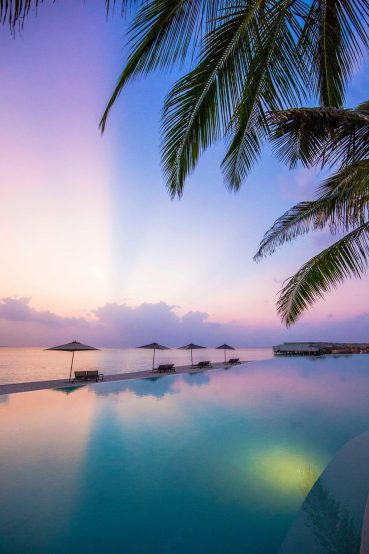 Amilla Fushi Luxury Resort and Residences - Baa Atoll, Maldives - Pool Reflections Sunset