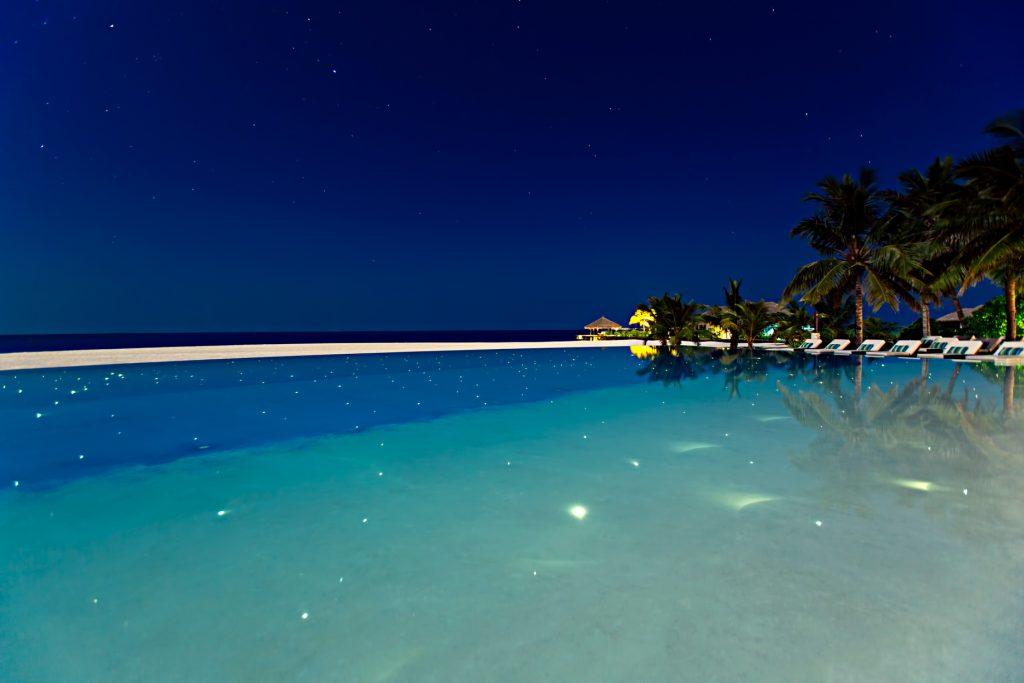 Velassaru Maldives Luxury Resort - South Male Atoll, Maldives - Pool Night