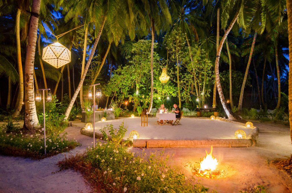 Amilla Fushi Luxury Resort and Residences - Baa Atoll, Maldives - Palm Tree Courtyard Dining Night