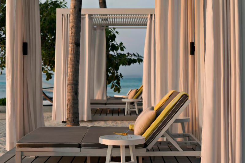 Cheval Blanc Randheli Luxury Resort - Noonu Atoll, Maldives - Beach Club Lounge Chairs Sunset