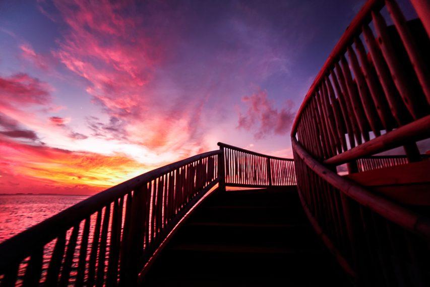 Soneva Jani Luxury Resort - Noonu Atoll, Medhufaru, Maldives - So Starstruck Overwater Dining Stairs Sunset