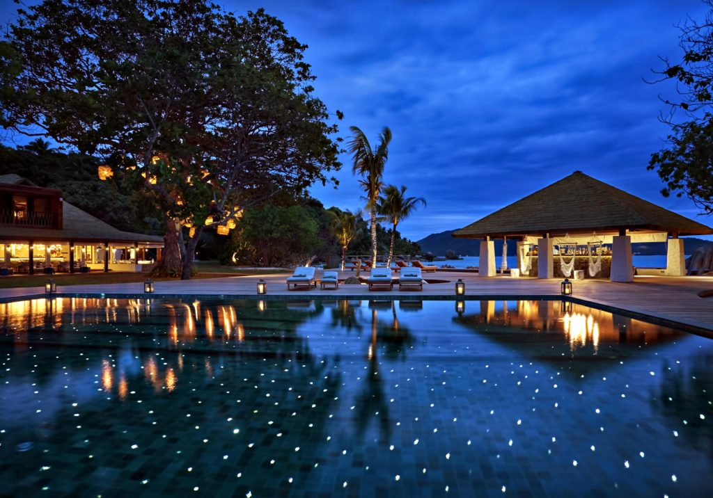 Six Senses Zil Pasyon Luxury Resort - Felicite Island, Seychelles - Main Pool Deck Twilight